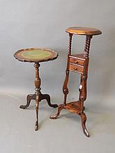 A mahogany wine table on a shaped support with tri