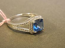 A silver and blue topaz set ring, size S