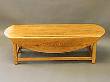 An oak drop leaf occasional table on square chamfe