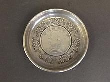 A small Chinese white metal coin dish with central