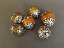 Six large decorative beads with white metal scroll