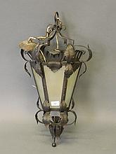 A coppered metal hall lantern with pierced leaf de