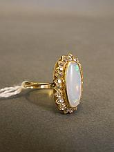 A lady's yellow gold ring set with a large oval op
