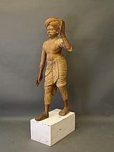 A C19th Indian carved hardwood figure of a man in