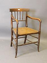 A William IV beechwood elbow chair with bobbin tur