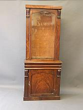 A Victorian mahogany bookcase with carved moulding