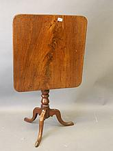 A C19th mahogany tilt top table with later figured