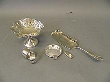 A Hallmarked silver ashtray and two napkin rings,
