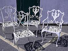 Four painted metal Victorian style garden chairs w