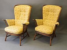 A pair of Ercol stained beech armchairs, 40'' high