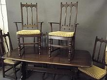 An Ercol dark oak dining table and six chairs, 72'