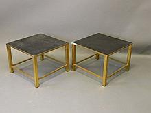 A pair of brass occasional tables with laminated t