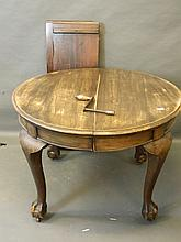 A Victorian walnut wind-out table with two leaves,