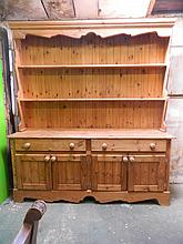 A pine dresser, the base with two drawers over two