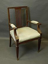 A stained beech elbow chair with pierced splat bac