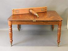 A Victorian mahogany pull out dining table on turn
