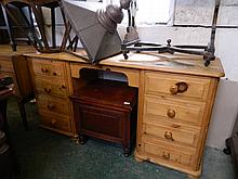 A pine kneehole desk with eight drawers, 58'' x 17