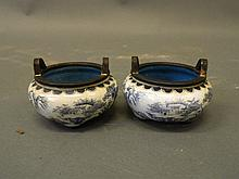 A pair of Chinese twin handled bronze censers with