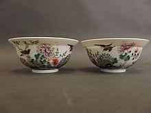 A pair of fine porcelain bowls decorated in bright enamels with flowers, bi