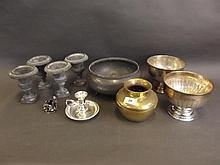 Four small lead classical urns, a pewter fruit bowl, two silver plate pedes