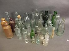 A collection of various antique bottles and stoneware jars (32)