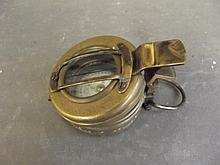 A brass military compass, marked 'T.G. & Co. Ltd., London 1943, MK III', 2Â