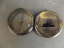 A contemporary small brass compass decorated with the Titanic, 2½