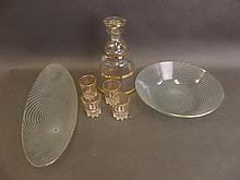Two Studio glass Whirl pattern dishes, and a gilt decorated liqueur decante
