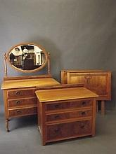 An Edwardian satin walnut dressing table and matching chest of drawers, wit