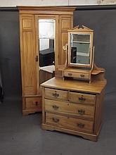 A satin walnut single door wardrobe with mirrored door over a single drawer