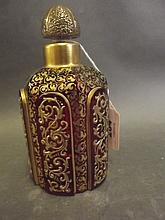 A good C19th Bohemian ruby glass bottle and stopper with raised gilt decora
