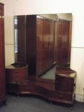 A Colonial mahogany triple mirror dressing table with six carved upper draw