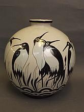 A large bulbous pottery vase decorated with