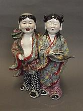 A Chinese porcelain figure group of a boy and girl