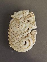 A Chinese white soapstone pendant carved in the