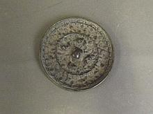 An early Chinese circular bronze mirror, 4¼''
