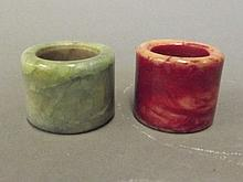 A Chinese green jade archers ring, and a red