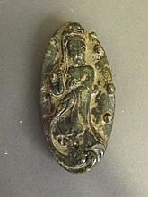 A Chinese green hardstone oval pendant carved in