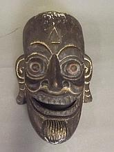 A carved and lacquered ceremonial wooden mask,