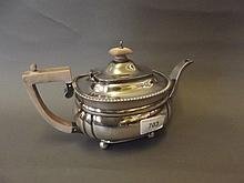 A Hallmarked silver teapot retailed by Harrods,