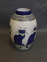 An Art Pottery vase with stylised cat decoration,
