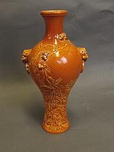 A Chinese brown glazed pottery vase with relief