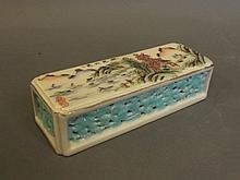 A Chinese pierced edge wrist rest with painted
