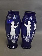 A pair of blue glass vases with Mary Gregory style