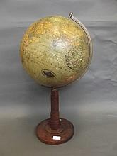An Edwardian 'Columbus Erdglobus' globe on an oak