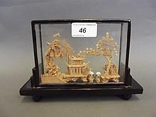 A Chinese cork carving depicting cranes, pavilions
