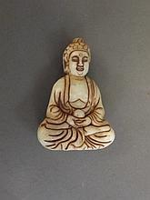 A Chinese carved hardstone figure of a seated
