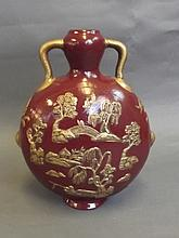 A Chinese sang-de-boeuf twin handled moon flask