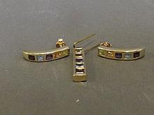A 9ct gold pendant and earring set with garnet,