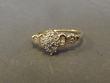 A 9ct gold baguette diamond and diamond cluster